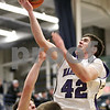 Rob Winner – rwinner@shawmedia.com<br /> <br /> Hampshire's Tyler Crater (42) puts up two points in the second quarter during the Class 3A Burlington Central Regional final in Burlington, Ill., Friday, Mar. 1, 2013.