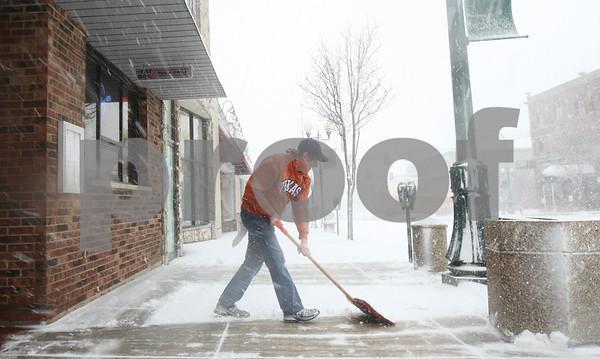 Kyle Bursaw – kbursaw@shawmedia.com<br /> <br /> Fat Boyz bartender Mike Jenkin shovels in front of the establishment on Tuesday, Feb. 26, 2013.