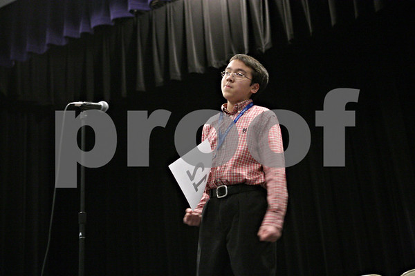 "Rob Winner – rwinner@shawmedia.com<br /> <br /> Matthew Rogers, 12, of Sycamore Middle School, reacts after correctly spelling ""megalopolis"" in the 14th round to win the DeKalb County Spelling Bee at Kishwaukee College in Malta, Ill., Saturday, Feb. 23, 2013."