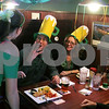 Gary Gates - For the Daily Chronicle<br /> Kevin Frank (center), of Downers Grove, gestures speaks with O'Leary's Restaurant and Pub waitress Makaela Huerta during St. Patrick's Day festivities on Sunday.  Friend Pat Scaccia looks on from his side.