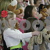 "Rob Winner – rwinner@shawmedia.com<br /> <br /> First grader Cheyenne Fay (front) holds up a stuffed animal dog while performing ""A Mud Puddle Jumped on Me!"" during Friday morning's Grandparents Day at Shabbona Elementary School."