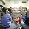 "Rob Winner – rwinner@shawmedia.com<br /> <br /> Three-year-old Isaac Smith, of DeKalb, looks back to his mother while reacting to the music of Nathan Dettman and Rebecca Hodson during story time  at the DeKalb Public Library on Tuesday, March 19, 2013. ""I want the snow to melt so it can be spring,"" said Smith after learning that the theme of story time on Tuesday was all about spring."