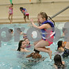 Rob Winner – rwinner@shawmedia.com<br /> <br /> MacKenzie Ferguson of Southeast Elementary in Sycamore jumps into a pool at the Kishwaukee Family YMCA in Sycamore, Ill., Friday, March 22, 2013. Ferguson is part of the OSCAR program, or out of school care program, which involves a partnership between Sycamore schools and the YMCA. Sycamore schools started their spring break on Friday and will return for class on Monday, April 1.