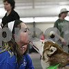 Rob Winner – rwinner@shawmedia.com<br /> <br /> Cassidy Gould, 13, of Sycamore, receives a kiss from Hawk in front of the Raven's Husky Haven and Rescue booth during the 2013 Community Expo inside the field house at Sycamore High School on Tuesday, March 26, 2013.