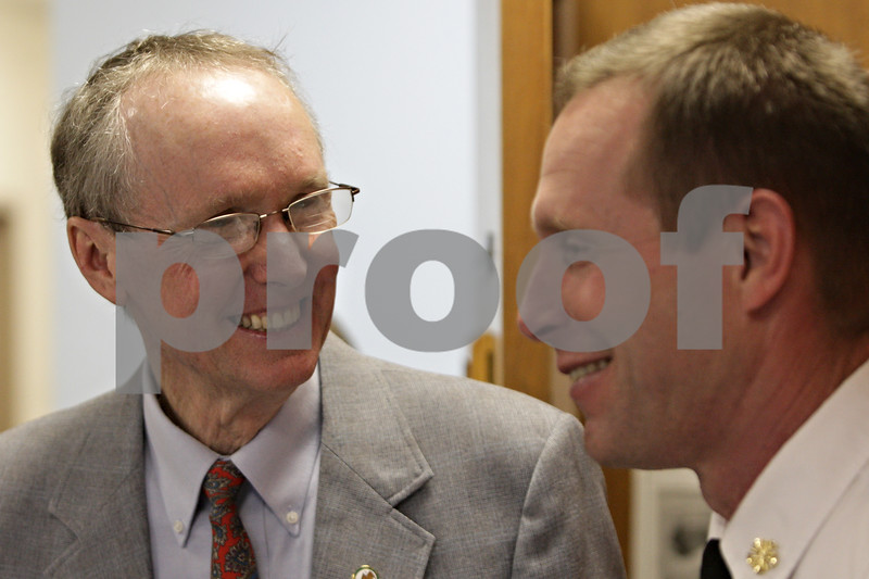 Rob Winner – rwinner@shawmedia.com<br /> <br /> Mayor Kris Polvsen (left) speaks with Fire Chief Eric Hicks before Polvsen's final DeKalb City Council meeting on Monday, April 22, 2013.<br /> <br /> DeKalb, Ill.