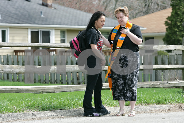 Rob Winner – rwinner@shawmedia.com<br /> <br /> The Reverend Amy Fallon, of Grace Place Campus Ministry, prays with Northern Illinois University student Nina Spillone outside St. Paul's Episcopal Church in DeKalb, Ill., Tuesday, April 30, 2013. The event at St. Paul's, #Prayers2Pass, offered passersby snacks, drinks and prayers to those who wanted them.