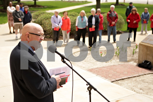 Rob Winner – rwinner@shawmedia.com<br /> <br /> Pastor Dan Stovall, of Sycamore Baptist Church, speaks during the National Day of Prayer event outside the DeKalb County Courthouse in Sycamore, Ill., Thursday, May 2, 2013.