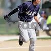 Monica Maschak - mmaschak@shawmedia.com<br /> Eduardo Canchola runs to first base in a ball game between Hiawatha and Hinckley-Big Rock on Wednesday, May 1, 2013. The Royals beat the Hawks 5-4.