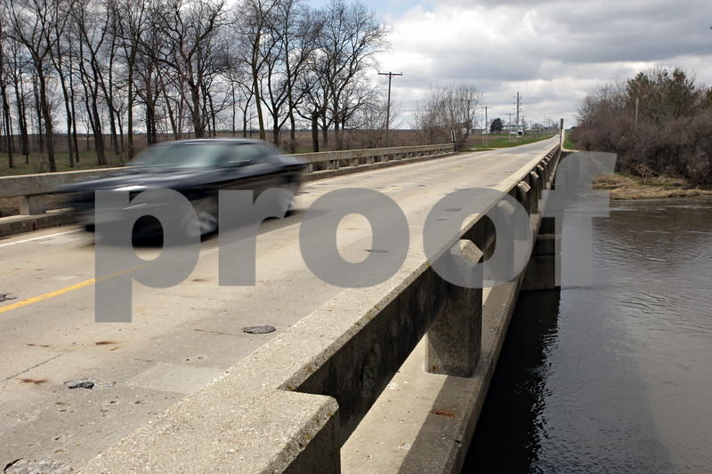 Rob Winner – rwinner@shawmedia.com<br /> <br /> A vehicle is seen crossing over the Kishwaukee River on Baseline Road just south of Genoa, Ill., Thursday, April 25, 2013. The bridge is slated for construction later this year.