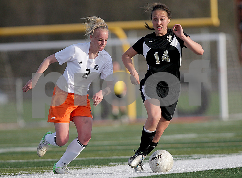 Monica Maschak - mmaschak@shawmedia.com<br /> Sycamore's Katherine Kohler paces with the ball followed by DeKalb's Kelli Cardine in the first half of the soccer game on Tuesday, April 30, 2013. Sycamore lost to DeKalb 1-0.