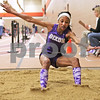 Monica Maschak - mmaschak@shawmedia.com<br /> Lexy Duncan, for Dixon, sticks her landing in the long jump event at the Northern Illinois Big 12 Conference Girls Track and Field Championships at DeKalb High School on Friday, May 3, 2013.