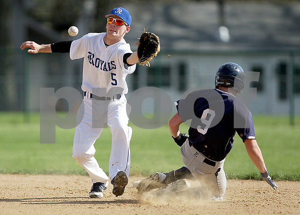 Monica Maschak - mmaschak@shawmedia.com<br /> Jacob Ryan (5) reaches for a ball as Nick Doolittle (9) slides into second base in a ball game between Hiawatha and Hinckley-Big Rock on Wednesday, May 1, 2013. The Royals beat the Hawks 5-4.