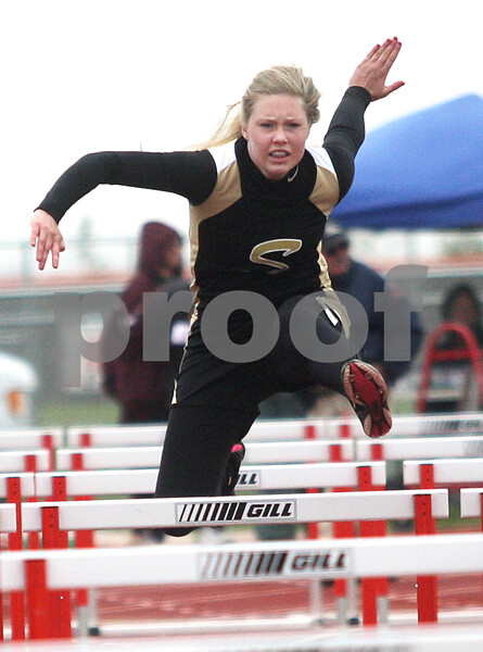 Monica Maschak - mmaschak@shawmedia.com<br /> Lilia Edwards, for Sycamore, eyes the obstacle ahead during the 110 meter preliminary hurdles event at the Northern Illinois Big 12 Conference Girls Track and Field Championships at DeKalb High School on Friday, May 3, 2013.
