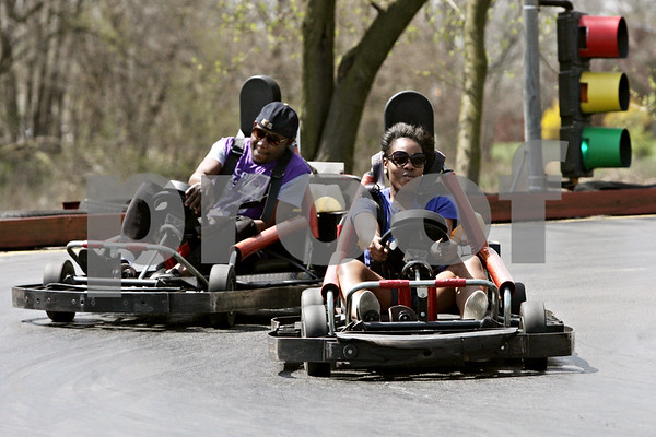 Rob Winner – rwinner@shawmedia.com<br /> <br /> Friends Taneisha Brown (front) and Larry Brown, both of DeKalb, ride the go-karts at Sycamore Family Sports Center on Tuesday afternoon. The pair just wanted to take advantage of the warm weather in the DeKalb area on the last day of April.