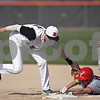 Rob Winner – rwinner@shawmedia.com<br /> <br /> DeKalb's Logan Haring (15) tags out Yorkville baserunner Joe Orisek for the second out in the top of the first inning in DeKalb, Ill., Monday, April 29, 2013.