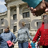 Rob Winner – rwinner@shawmedia.com<br /> <br /> (From left to right) Joan Vancil, of Sycamore, Nancy Tucker and Christine Militz, both of DeKalb, hold hands while praying for the sick and hurting of DeKalb county during the National Day of Prayer event outside the DeKalb County Courthouse in Sycamore, Ill., Thursday, May 2, 2013.