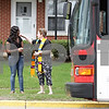 Rob Winner – rwinner@shawmedia.com<br /> <br /> The Reverend Amy Fallon (right), of Grace Place Campus Ministry, offers to pray for a woman waiting for the bus near St. Paul's Episcopal Church in DeKalb, Ill., Tuesday, April 30, 2013. The event at St. Paul's, #Prayers2Pass, offered passersby snacks, drinks and prayers to those who wanted them.