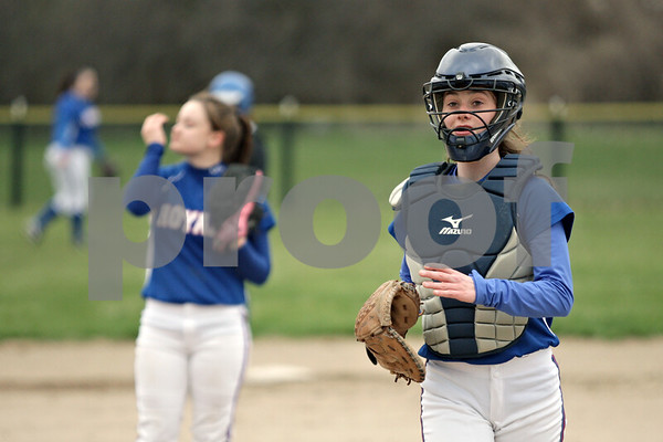 Rob Winner – rwinner@shawmedia.com<br /> <br /> Hinckley-Big Rock catcher Mary Kate Harrod (right) heads back to her position after a meeting at the mound with pitcher Kenzie Coppes in the bottom of the second inning during a game in Newark, Ill., Tuesday, April 16, 2013.
