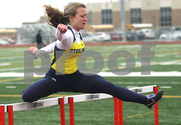 Monica Maschak - mmaschak@shawmedia.com<br /> Ashleigh Tira clears a hurdle during the 110 meter preliminary hurdle event at the Northern Illinois Big 12 Conference Girls Track and Field Championships at DeKalb High School on Friday, May 3, 2013.