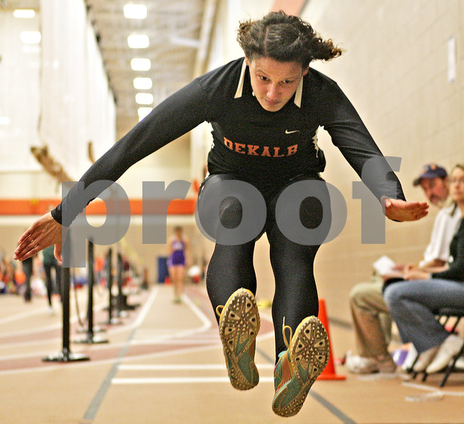 Monica Maschak - mmaschak@shawmedia.com<br /> Jasmin Brown, for DeKalb, makes air in the long jump event at the Northern Illinois Big 12 Conference Girls Track and Field Championships at DeKalb High School on Friday, May 3, 2013.