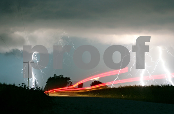 Rob Winner – rwinner@shawmedia.com<br /> <br /> Brake lights from a pickup truck heading westbound on Owens Road near the intersection of Somonauk and Owens Roads in Pierce Township can be seen as lightning strikes during a thunderstorm on Wednesday, July 18, 2012.