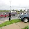 Rob Winner – rwinner@shawmedia.com<br /> <br /> A Sycamore police officer photographs one of several vehicles involved in an accident on DeKalb Avenue near Oakland Drive in Sycamore on Thursday, May 9, 2013.<br /> <br /> Sycamore, Ill.
