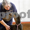 Monica Maschak - mmaschak@shawmedia.com<br /> Karen Hoffman praises her two-year-old Doberman Pinscher, Emma, after practicing a technique correctly during a basic obedience class for dogs at Haish Gym in DeKalb. The basic obedience classes run every Wednesday at the gym from 6:30 p.m. - 7:30 p.m.