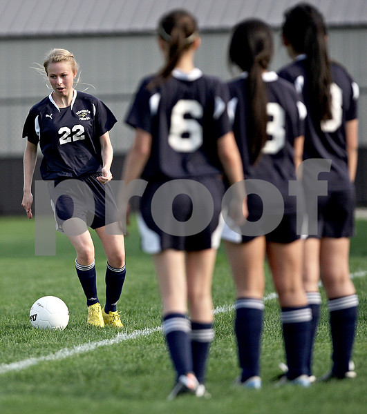 Monica Maschak - mmaschak@shawmedia.com<br /> Ida Bentzon keeps the ball inbounds as her Hiawatha teammates watch from the sidelines in the Class 1A Genoa-Kingston Regional semifinal game on Wednesday, May 8, 2013. The Cogs beat Hiawatha 4-1.