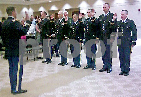Photo by Andrea Azzo for Shaw Media<br /> Cadets Konrad Dalecki, David Cutsinger, Derek Ma, Edward Tolle, Matthew Taylor and Bradley Wilson raise their hands to become second lieutenants.