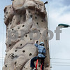 Erik Anderson - For the Daily Chronicle<br /> Jake Draper, 11, of Sycamore climbs to the top of a rock climbing wall hosted by the Boy Scouts of America Troop #16 and #40 during the 16th annual Cinco De Mayo Festival in downtown Sycamore behind Taxco restaurant on Sunday, May 5, 2013. The festival is open to the public Sunday, May 5th from 1pm-9pm.