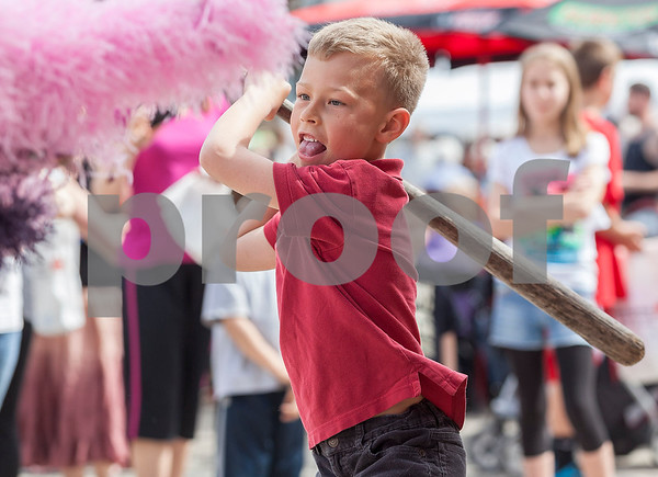 Erik Anderson - For the Daily Chronicle<br /> Jonny Locascio, 7, of Sycamore winds up his bat before smashing into a Piniata which was hosted by the Boy Scouts of America during the 16th annual Cinco De Mayo Festival in downtown Sycamore behind Taxco restaurant on Sunday, May 5, 2013. The festival is open to the public Sunday, May 5th from 1pm-9pm.