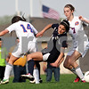 Monica Maschak - mmaschak@shawmedia.com<br /> Hiawatha's Yulissa Solis take a tumble between Genoa-Kingston's Allie Pfeiffer and Abbey Rasmussen in the Class 1A Genoa-Kingston Regional semifinal game on Wednesday, May 8, 2013. The Cogs beat Hiawatha 4-1.