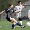 Monica Maschak - mmaschak@shawmedia.com<br /> Hiawatha's Cassandra Barrett kicks the ball before Ixtel Viramontes (9) can reach it in the Class 1A Genoa-Kingston Regional semifinal game on Wednesday, May 8, 2013. The Cogs beat Hiawatha 4-1.
