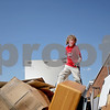 Monica Maschak - mmaschak@shawmedia.com<br /> Timothy McMahon, 12, stands on top of a dumpster full of furniture and other miscellaneous items that was left in the old Dekalb Clinic, which has been vacant since 2009. The building was auctioned off last month and purchased by Timothy's father, Bill McMahon, within the last couple weeks. McMahon has plans to turn the building into a banquet hall.