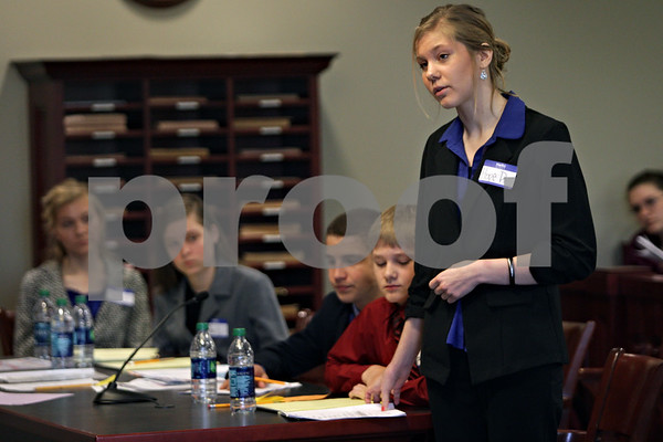 Rob Winner – rwinner@shawmedia.com<br /> <br /> Hope Pavelski, 18 of Appleton, Wis., questions a witness while taking on the role of a defense attorney during a mock trial at the DeKalb County Courthouse in Sycamore, Ill., Wednesday, May 8, 2013.
