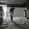 Monica Maschak - mmaschak@shawmedia.com<br /> Timothy McMahon (left), 12, and his friend Daniel Yonke, 13, walk through an empty former Dekalb Clinic, which has been vacant since 2009 and was recently auctioned and purchased by Timothy's father, Bill McMahon, in the last couple weeks. McMahon has plans to turn the building into a banquet hall. His two sons and their friends helped with cleaning out the building from furniture and other items left behind by the clinic four years ago.