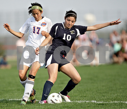 Monica Maschak - mmaschak@shawmedia.com<br /> Hiawatha's Yulissa Solis takes possession of the ball from Nicole Hebel (17) in the Class 1A Genoa-Kingston Regional semifinal game on Wednesday, May 8, 2013. The Cogs beat Hiawatha 4-1.