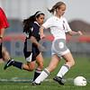 Monica Maschak - mmaschak@shawmedia.com<br /> Katie Gahlbeck dribbles the ball down the field in the Class 1A Genoa-Kingston Regional semifinal game on Wednesday, May 8, 2013. The Cogs beat Hiawatha 4-1.