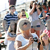 Rob Winner – rwinner@shawmedia.com<br /> <br /> Valerie Zandanel (front), of DeKalb, tries to catch a glimpse of Dennis Quaid as filming for a movie starring Quaid and Zac Efron continues at Sycamore Speedway in Maple Park on Saturday, Oct. 8, 2011.