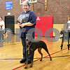 Monica Maschak - mmaschak@shawmedia.com<br /> Karen Hoffman and her two-year-old Doberman Pinscher, Emma, await their turn to practice a lesson during a basic obedience class for dogs at Haish Gym in DeKalb. The basic obedience classes run every Wednesday at the gym from 6:30 p.m. - 7:30 p.m.