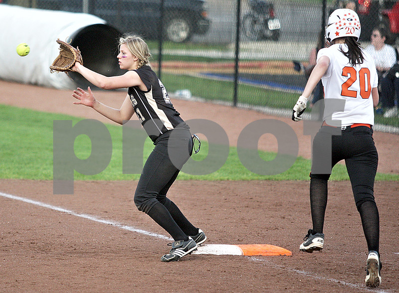 Monica Maschak - mmaschak@shawmedia.com<br /> Brittany Huber, for Sycamore, waits for the ball to hit her mitt as DeKalb's Haley Tadd races to first base in a rivalry game at Northern Illinois University on Tuesday, May 7, 2013. The Barbs beat the Spartans 4-3.