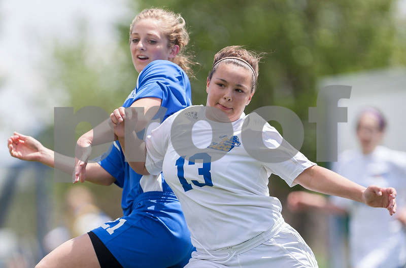 Erik Anderson - For the Daily Chronicle<br /> Aurora Central Catholic midfielder Rebecca Park (13) leans into Hinckley-Big Rock forward Lauren Paver while fighting for control of the ball during the second half as HBR and ACC played at Hinckley-Big Rock High School in Hinckley on Saturday, May 11, 2013. The Royals defeated the Chargers 8-1 during the regional game.