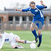 Erik Anderson - For the Daily Chronicle<br /> Aurora Central Catholic midfielder Riley Spanu (19), trips and falls to the ground as Hinckley-Big Rock midfielder Lauren Umano hops over the ball during the match up of HBR and ACC at Hinckley-Big Rock High School in Hinckley on Saturday, May 11, 2013. The Royals defeated the Chargers 8-1 during the regional game.