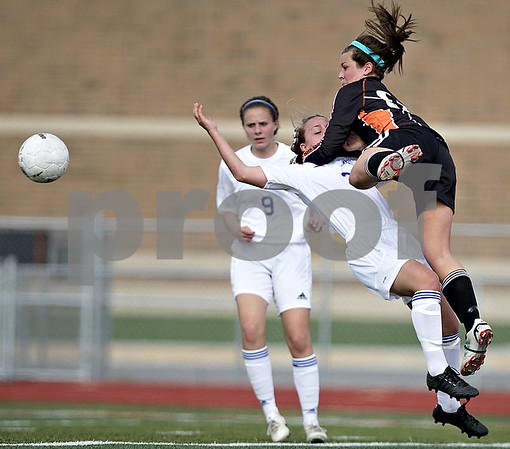 Monica Maschak - mmaschak@shawmedia.com<br /> DeKalb goalie Maddie Frye collides with St. Charles North's Alex Gage in an attempt to save the ball in the Class 3A DeKalb Regional semifinals on Wednesday, May 15, 2013. The North Stars beat The Barbs 5-1.