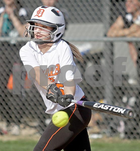 Monica Maschak - mmaschak@shawmedia.com<br /> Rachel Johnson makes a hit in a game at Kaneland High School on Thursday, May 16, 2013. The Knights shut out the Barbs 4-0.