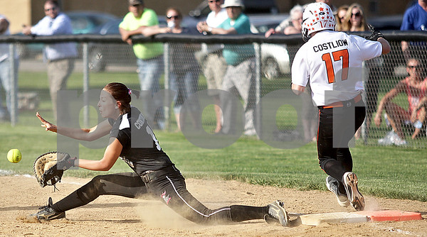 Monica Maschak - mmaschak@shawmedia.com<br /> Hayley Contorno, for Kaneland, lounges for the ball in an attempt to tag out DeKalb's Lindsey Costliow in a game at Kaneland High School on Thursday, May 16, 2013. The Knights shut out the Barbs 4-0.