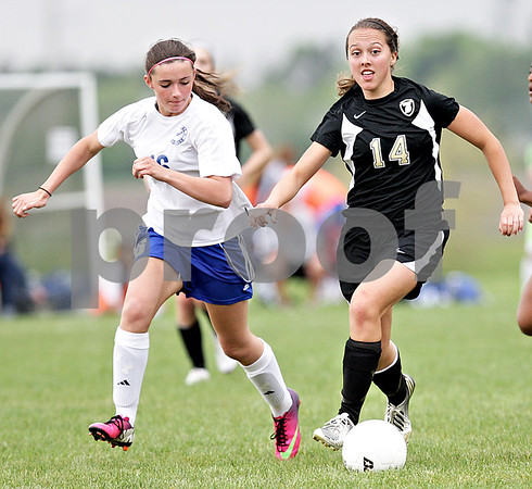 Monica Maschak - mmaschak@shawmedia.com<br /> Katherine Kohler eyes for a teammate to pass to in the Class 2A Sycamore Regional finals against Burlington on Friday, May 17, 2013. The Spartans won 1-0.