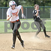 Monica Maschak - mmaschak@shawmedia.com<br /> DeKalb's Haley Tadd makes a run for third base in a game at Kaneland High School on Thursday, May 16, 2013. The Knights shut out the Barbs 4-0.