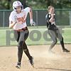 Monica Maschak - mmaschak@shawmedia.com<br /> DeKalb's Haley Tadd makes a run for third base in a game at Kaneland High School on Thursday, May 16, 2013. The Knights shut out the Barbs 4-0.
