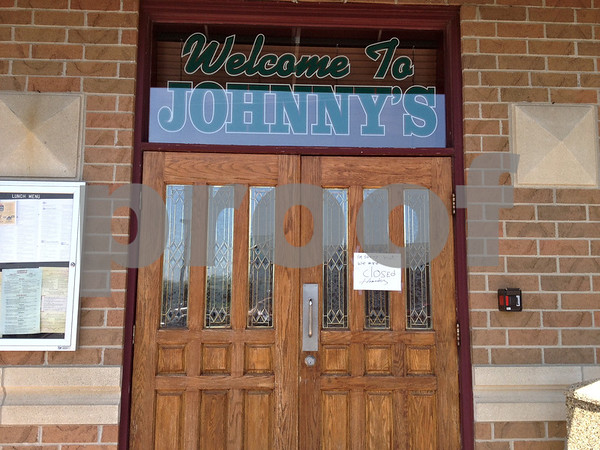 Stephanie Hickman - shickman@shawmedia.com<br /> <br /> A handwritten sign posted on Johnny's Charhouse main doors Monday states the business is closed.
